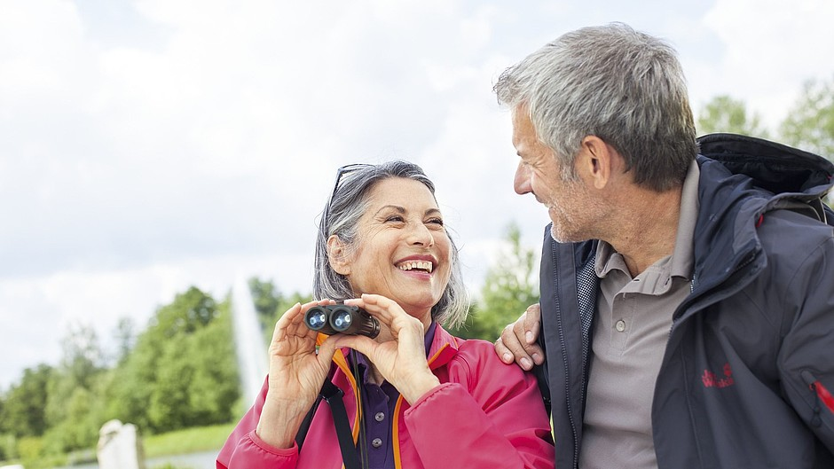 Elderly people with binoculars